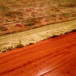 Do mineral spirits remove finish from engineered hardwood flooring?